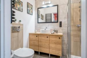 A bathroom at Best4Stay Apartment