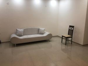 A seating area at Lucknow Condominium
