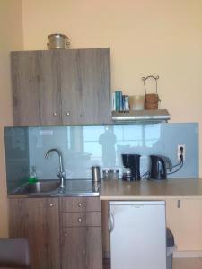 Η κουζίνα ή μικρή κουζίνα στο Blue Studios
