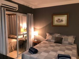 Cama o camas de una habitación en Comfortable & Economic Acqua Village