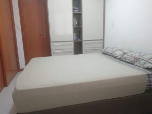 A bed or beds in a room at Apartamento Salvador Prime - 28 Andar