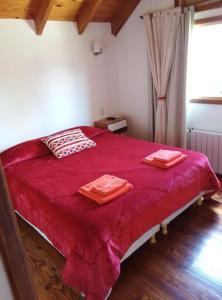 Una cama o camas en una habitación de wefko
