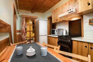 Kuchyň nebo kuchyňský kout v ubytování Apartments Penzion Štôla