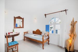 A bed or beds in a room at Annio Flats
