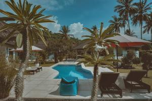 A view of the pool at Villa Paradise or nearby