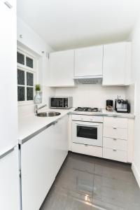 Küche/Küchenzeile in der Unterkunft 23 Courtfield Gardens