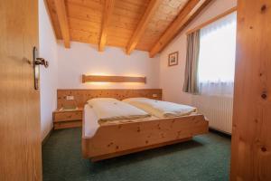 Ein Bett oder Betten in einem Zimmer der Unterkunft Ferienheim Gabi