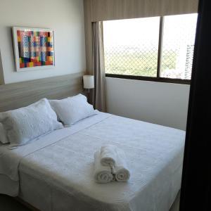 A bed or beds in a room at Suites em Boa Viagem