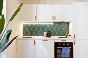 A kitchen or kitchenette at Olala Diagonal Apartment