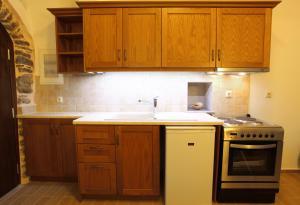 Küche/Küchenzeile in der Unterkunft STOES Traditional Suites