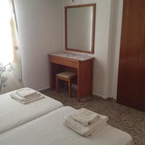 A bed or beds in a room at Villa Thalia