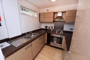 A kitchen or kitchenette at Dreamhouse Apartments Manchester City Centre