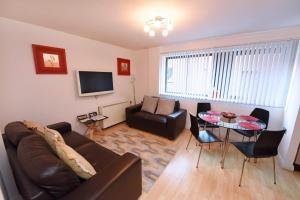 A seating area at Dreamhouse Apartments Manchester City Centre
