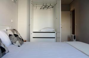 A bed or beds in a room at Sun House
