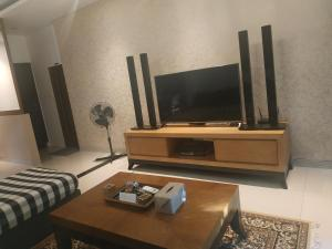 A television and/or entertainment centre at Saka Umah 2 Bedroom with private pool