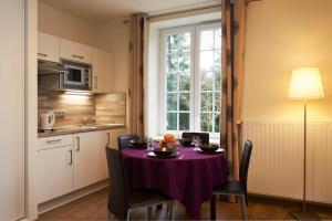 Cuisine ou kitchenette dans l'établissement La Villa Bel-Air