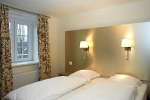 Un ou plusieurs lits dans un hébergement de l'établissement La Villa Bel-Air
