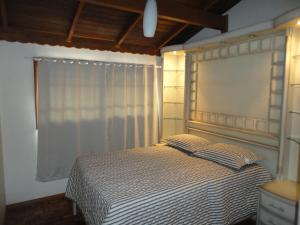 A bed or beds in a room at Apartamento Portinari