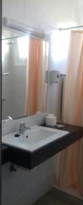 Een badkamer bij Apartamentos Pez Azul