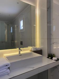 A bathroom at 24K Athena Suites