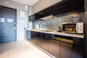 A kitchen or kitchenette at Summertime Maritime Suites