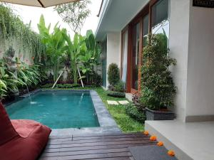 The swimming pool at or close to The Satya Villa