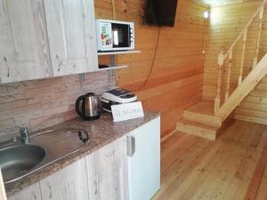 """A kitchen or kitchenette at Домики """"Северное сияние II первая линия от моря"""