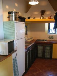 Una cocina o zona de cocina en Huerta Nueva
