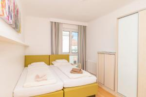 A bed or beds in a room at Appartements Ferchergasse