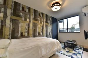 A bed or beds in a room at Modern La Fonte Minamirokugoモダンラフォンテ南六郷#102