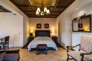 A bed or beds in a room at Naiades Guesthouse