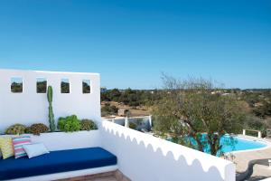 A view of the pool at La Masía de Formentera or nearby