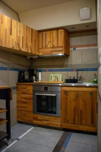 A kitchen or kitchenette at Handcrafted Unique Flat, 200m From The Acropolis