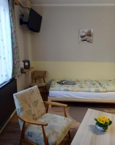 A bed or beds in a room at Jakus Ház