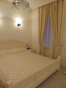Кровать или кровати в номере Апартаменты на Набережной