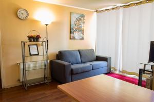 Zona de estar de VIP Apartments Chile