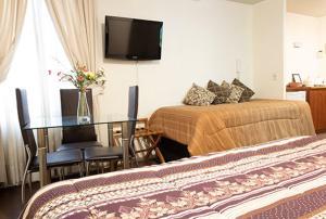 Cama o camas de una habitación en VIP Apartments Chile