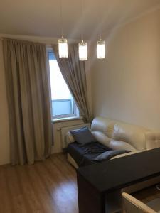 Гостиная зона в Апартаменты в Кудрово