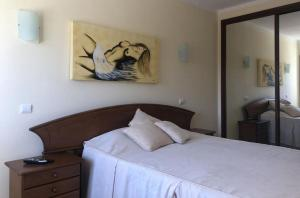 A bed or beds in a room at Akisol Alvor Sun