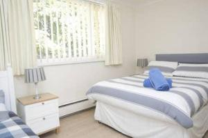 A bed or beds in a room at Large Detached House