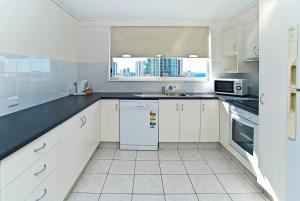 A kitchen or kitchenette at Centrepoint Resort