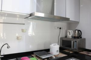 A kitchen or kitchenette at Hejmo Suites at Georgetown Penang