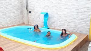 The swimming pool at or close to Casa Praia Antunes Maragogi