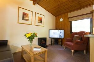 A seating area at Macdonald Lochanhully Resort