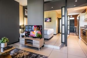 A television and/or entertainment center at CAG The Vantage Rosebank