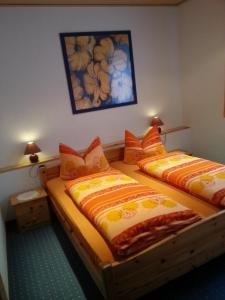 Ein Bett oder Betten in einem Zimmer der Unterkunft Haus Hinzberg