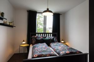 A bed or beds in a room at Gehobene Studio Wohnung in der Bochumer Innenstadt