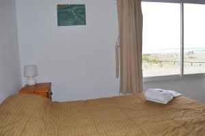 Una cama o camas en una habitación de Marina de las Pampas