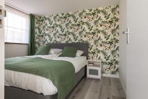 Een bed of bedden in een kamer bij Appartementen Parkzicht