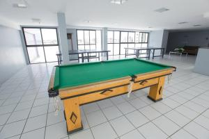 A billiards table at Flat Beira-Mar - NEO Pajuçara